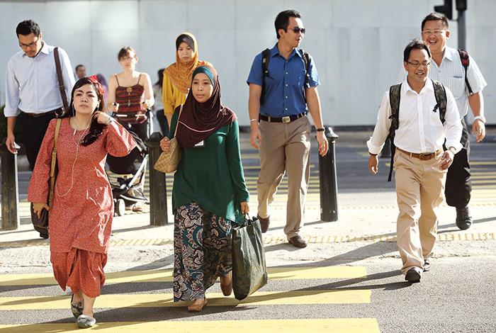 穿梭在吉隆坡市中心的上班 族,步調之快頗有讓人置身於香港的錯覺。