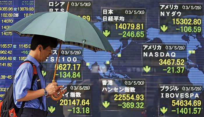 日股大跌和日圓止貶回升,顯示安倍經濟學面臨強大考驗。