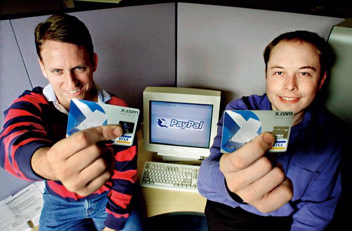 馬斯克(右)靠PayPal,31歲就成了億萬富翁。