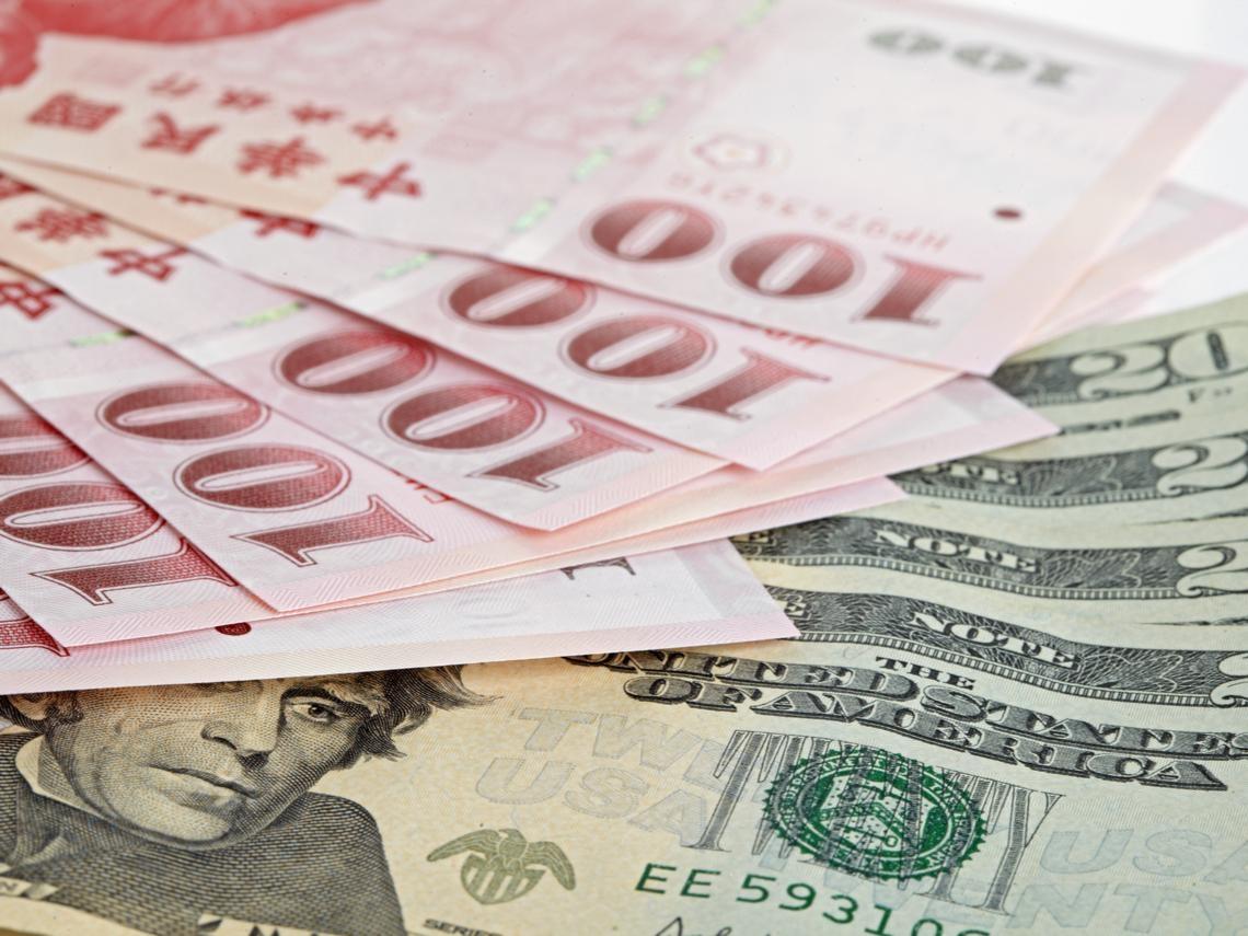 新台幣飆到28.4元!31.3元買的1.6萬美元定存快到期,我該怎麼辦?