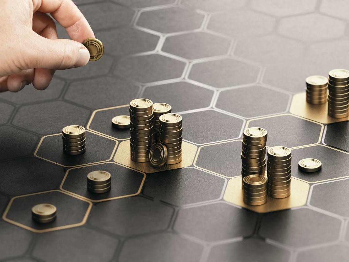 50元的聯電和國泰金,該買哪一檔?年領70萬股息投資達人的選擇是...